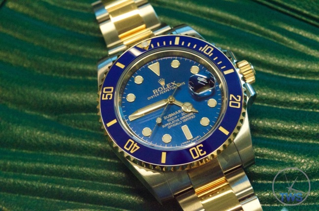 Rolex Oyster Perpetual Submariner Date 116613LB – Sitting on medium sized Rolex box