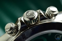 Hands-On Review: Rolex Cosmograph Daytona Stainless Steel ref. 116520 (Black) Rolex Daytona Stainless Steel crown and pusher buttons sitting on supplied green box