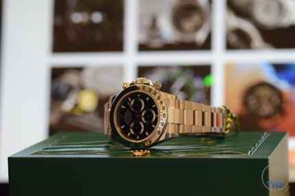 Hands-On Review: Rolex Cosmograph Daytona Stainless Steel ref. 116520 (Black) Rolex Daytona watch sitting on supplied green box with thewatchsource instagram in the background