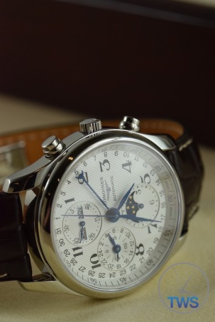 Longines Master Collection Moon Phase: Unboxing Review [L2.673.4.78.3] On side with crown side up in low light with dial illuminated