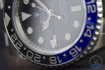 Review of the Rolex GMT Master II [116710BLNR] aka 'The Batman' Close up of the GMT's bezel and dial in low light