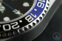 Review of the Rolex GMT Master II [116710BLNR] aka 'The Batman' Close up of bezel, GMT hand and 9 o'clock marker