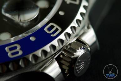 Review of the Rolex GMT Master II [116710BLNR] aka 'The Batman' Close up of the crown and bezel