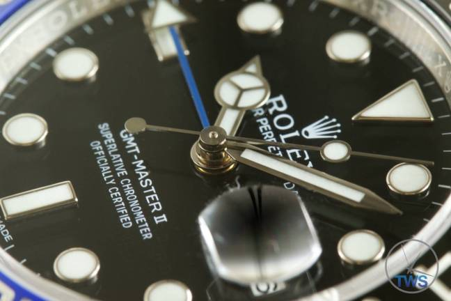 Review of the Rolex GMT Master II [116710BLNR] aka 'The Batman' Dial, hands, cyclops date window, hour markers and Rolex markings