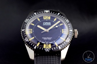 Oris Divers Sixty-Five closeup with a black background [01 733 7707 4064-07 4 20 18]