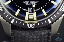 Oris Divers Sixty-Five closeup of bottom half of dial with the date window, 6 o'clock marker, bezel, lugs, strap and WATER RESISTANT 10 Bar markings [01 733 7707 4064-07 4 20 18]