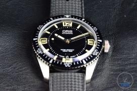 OrisDivers Sixty-Five closeup sitting on black leather [01 733 7707 4064-07 4 20 18]