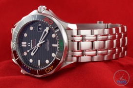 Omega Rio 2016 Olympic Limited Edition Seamaster Diver 300m: Hands On Review [522.30.41.20.01.001] - On a red background facing the left