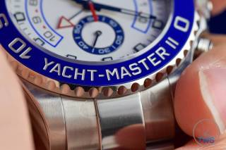 Watch in hand with bezel in focus - Rolex Yachtmaster II- Hands-On Review [116680]