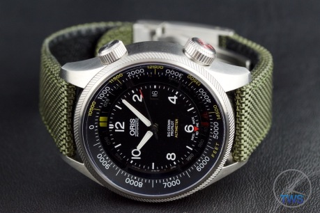 Oris Big Crown ProPilot Altimeter 47mm: Hands-On Review [01 733 7705 4134-07 5 23 14FC] - Laying on black leather on its side with time set to ten past ten and venting crown closed